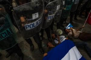 Una protesta en Managua contra el gobierno de Daniel Ortega. Cada semana hay protestas contra el control gubernamental de las elecciones, el congreso, la policía y el sistema de justicia. Credit Meridith Kohut para The New York Times.