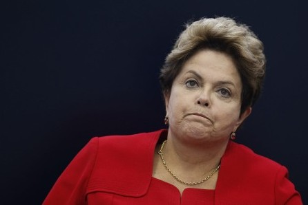 Brazil's President Dilma Rousseff reacts during a news conference to present the balance of the 2014 World Cup in Brasilia