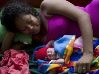 A mother lays next to her baby at the general hospital in Puerto Cabezas, in the North Atlantic Autonomous Region (RAAN) of Nicaragua.