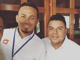 Los periodistas Gerall Chávez y Hector Rosales del canal 14 de televisión.